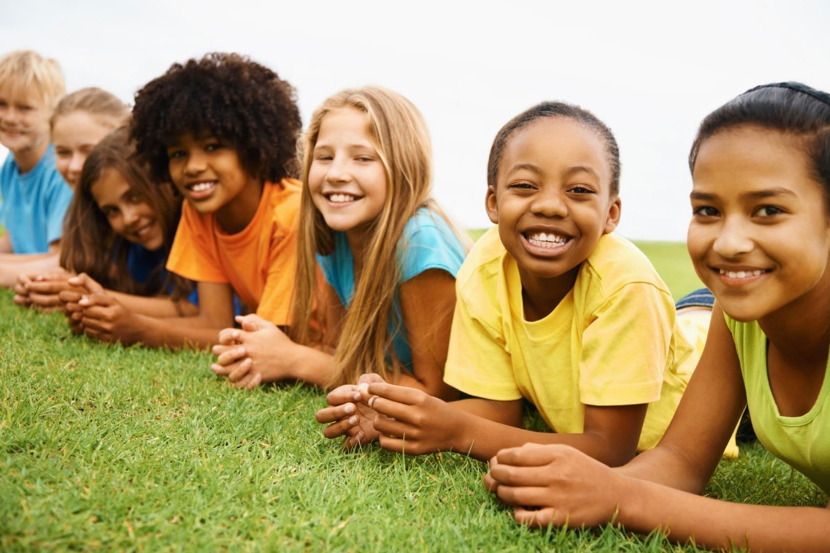 multicultural-children-laying-in-grass_0.jpg